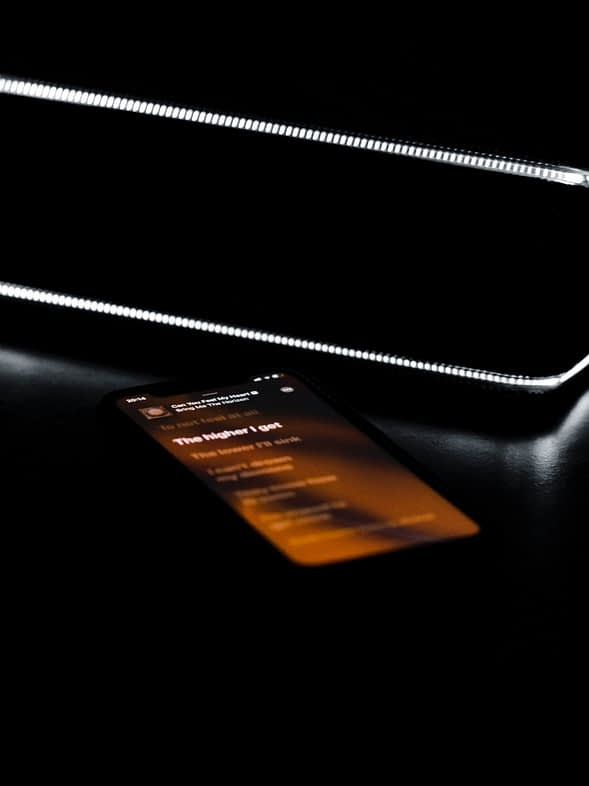 illustration of a smartphone light on laying on a black furniture